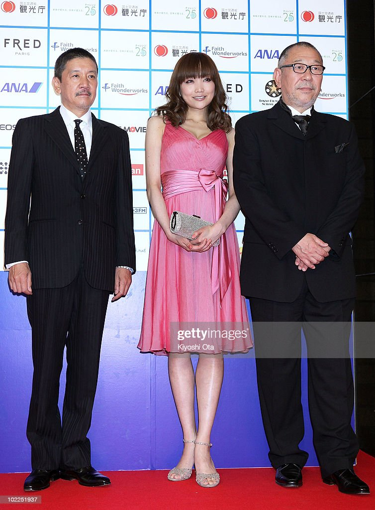 The jury members for the 'STOP! Global Warming' competition (L-R) actor Eiji Okuda, actress Eriko Sato and film director Yoichi Sai pose on the red carpet during the Short Shorts Film Festival & Asia 2010 Award Ceremony at Jingu Kaikan on June 20, 2010 in Tokyo, Japan. The annual festival is one of the Asia's largest festivals for international short films, and the Grand Prix winner, selected from the three official Best Short Award winners, will be eligible for an Academy Award nomination in the Short Films category.
