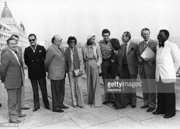 The jury members of the Cannes Film Festival pose on the terrace of the Palais des Festivals 13th May 1977 From left to right Maurice Bessy G Jacob...