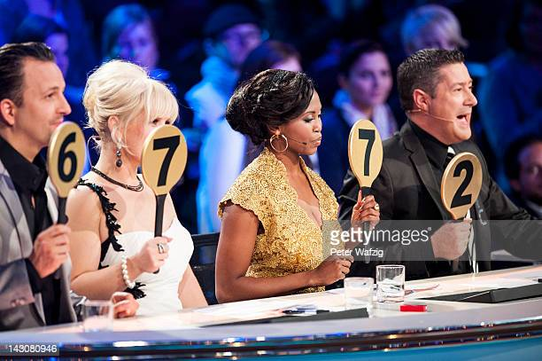 The jury members Roman Frieling Maite Kelly Motsi Mabuse and Joachim Llambi giving points for the perfomance during 'Let's Dance' 6th Show at...