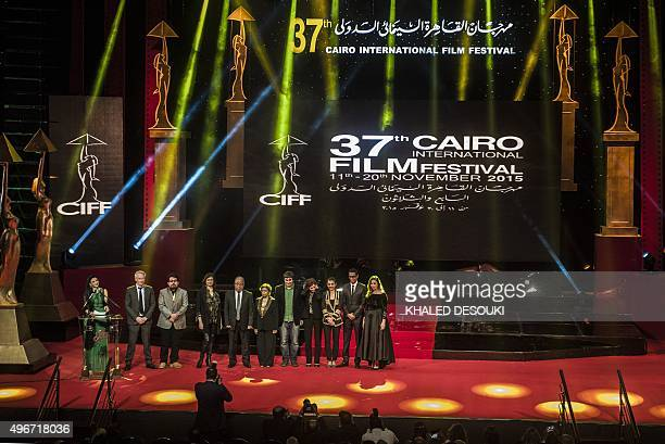 The jury of the 37th Cairo International Film Festival gather on stage during the opening ceremony of the 37th Cairo International Film Festival at...