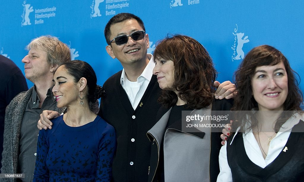 The jury of the 63rd Berlinale film festival (from L) German director and screenwriter Andreas Dresen (L), Iranian director Shirin Neshat, Hong Kong Chinese director Wong Kar-Wai, Danish director Susanne Bier and Greek director Athina Rachel Tsangari for photographers during a photocall in Berlin February 7, 2013. The 63rd Berlinale, the first major European film festival of the year, starts on February 7, 2013 with 24 productions screening in the main showcase.