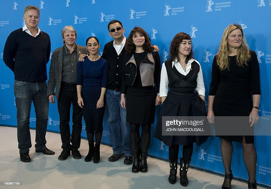 The jury of the 63rd Berlinale film festival (from L) US actor/director Tim Robbins, German director and screenwriter Andreas Dresen, Iranian director Shirin Neshat, Hong Kong Chinese director Wong Kar-Wai, Danish director Susanne Bier, Greek director Athina Rachel Tsangari and US cinematographer Ellen Kuras pose for photographers during a photocall in Berlin February 7, 2013. The 63rd Berlinale, the first major European film festival of the year, starts on February 7, 2013 with 24 productions screening in the main showcase.