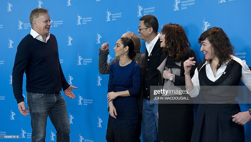 The jury of the 63rd Berlinale film festival (from L) US actor/director Tim Robbins, German director and screenwriter Andreas Dresen (hidden), Iranian director Shirin Neshat, Hong Kong Chinese director Wong Kar-Wai, Danish director Susanne Bier and Greek director Athina Rachel Tsangari for photographers during a photocall in Berlin February 7, 2013. The 63rd Berlinale, the first major European film festival of the year, starts on February 7, 2013 with 24 productions screening in the main showcase.