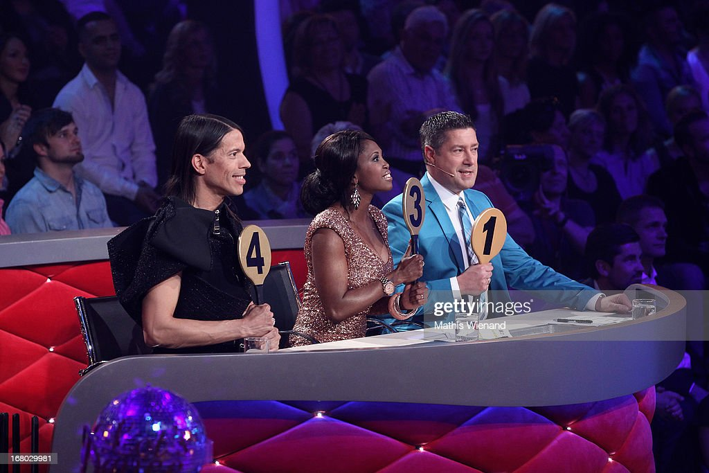 The Jury with (L-R) Jorge Gonzalez, Motsi Mabuse and <a gi-track='captionPersonalityLinkClicked' href=/galleries/search?phrase=Joachim+Llambi&family=editorial&specificpeople=4289289 ng-click='$event.stopPropagation()'>Joachim Llambi</a> give the points to Juergen Milski and Oana Andreea Nechit during the 5th Show of Let's Dance on RTL on May 3, 2013 in Cologne, Germany.