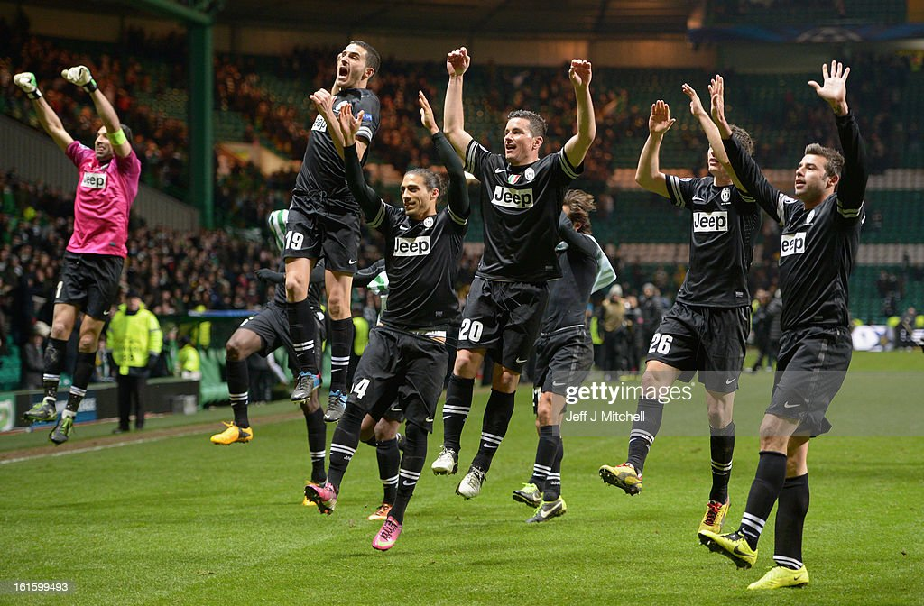 The Juventus players celebrate in front of their fans at the end of the UEFA Champions League Round of 16 first leg match between Celtic and Juventus at Celtic Park Stadium on February 12, 2013 in Glasgow, Scotland.