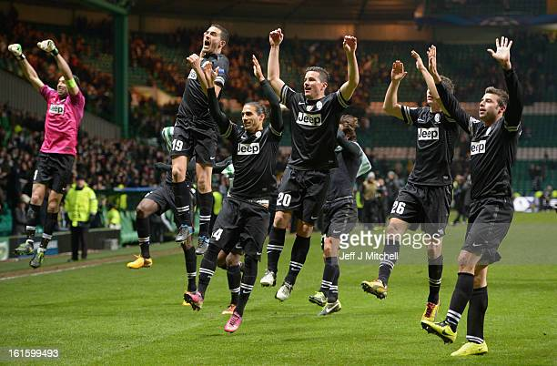 The Juventus players celebrate in front of their fans at the end of the UEFA Champions League Round of 16 first leg match between Celtic and Juventus...