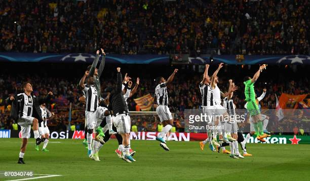 The Juventus team celebrate after the UEFA Champions League Quarter Final second leg match between FC Barcelona and Juventus at Camp Nou on April 19...