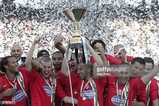The Juventus team celebrate winning the match and championship title after the Serie A match between Reggina and Juventus at the Stadio Granillo on...