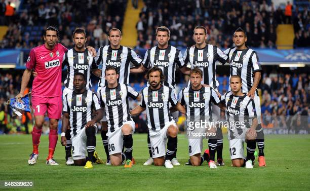 The Juventus team pose for a group picture prior to the UEFA Champions League match between Chelsea and Juventus at Stamford Bridge on September 19...