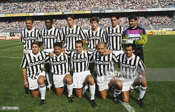 The Juventus team pose for a picture before a game in the 1992/93 season back row left to right Jurgen KohlerJulio Cesar Dino Baggio Andreas Moller...