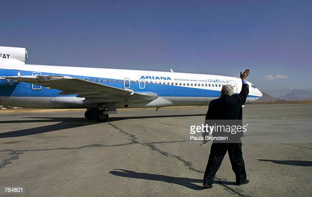 The Kabul Airport manager waves goodbye to the first Ariana Afghan Airlines international flight in 5 years January 24 2002 in Kabul Afghanistan The...