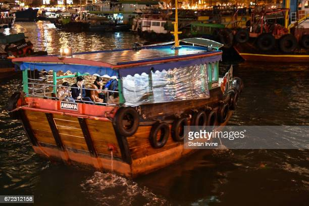The 'kaito' a small ferry in the form of a traditional Chinese sampan transports commuters and shoppers across Aberdeen harbour from Ap Lei Chau Hong...