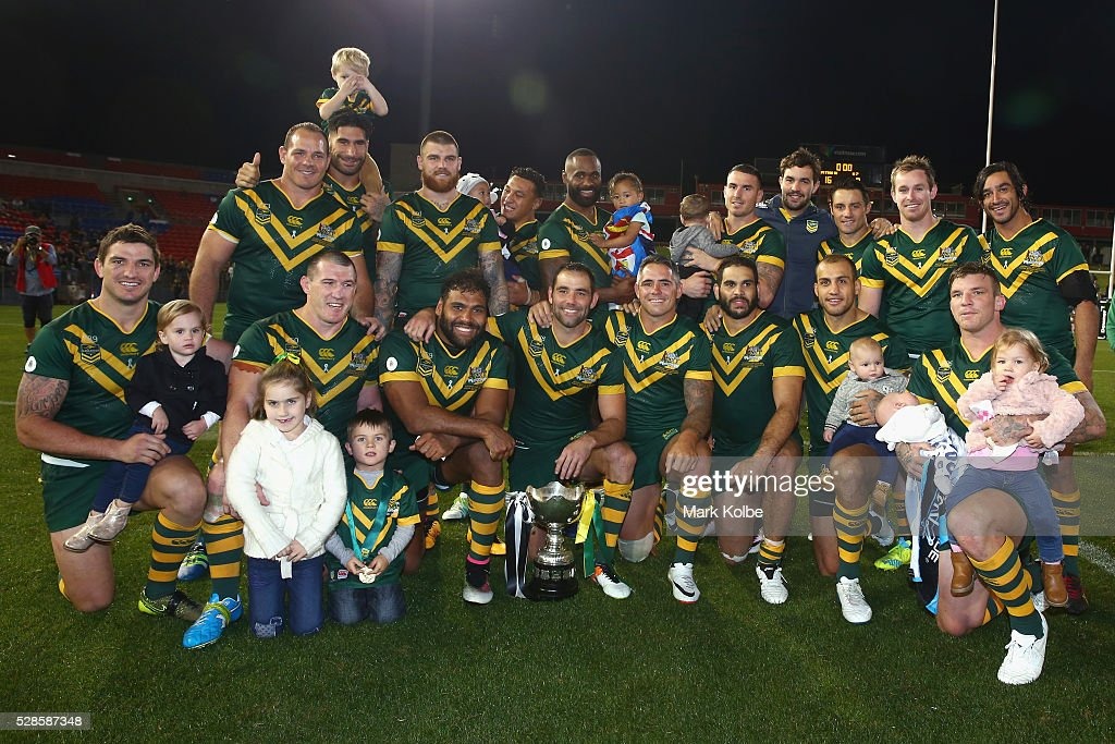 The Kanagroos pose with the trophy after victory during the International Rugby League Trans Tasman Test match between the Australian Kangaroos and the New Zealand Kiwis at Hunter Stadium on May 6, 2016 in Newcastle, Australia.