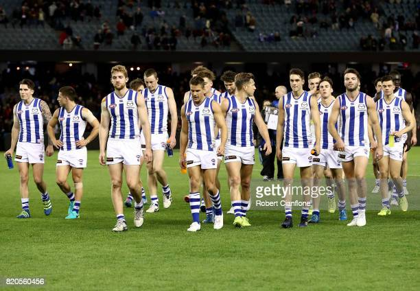 The Kanagroos walk off the ground after they were defeated by the Bombers during the round 18 AFL match between the Essendon Bombers and the North...