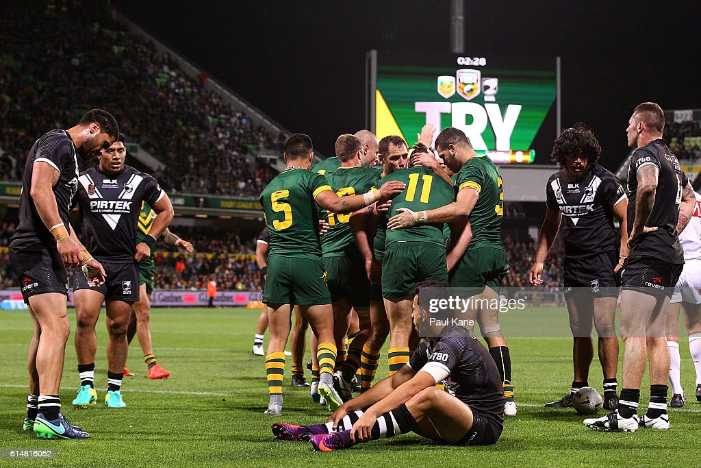 The Kangaroos celebrate a try as the Kiwi's look on during the International Rugby League Test match between the Australian Kangaroos and the New Zealand Kiwis at nib Stadium on October 15, 2016 in Perth, Australia.