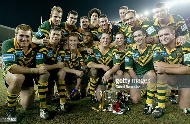 The Kangaroos pose for a team photograph after defeating the Lions after the Rugby League Test Match between the Australian Kangaroos and the Great...