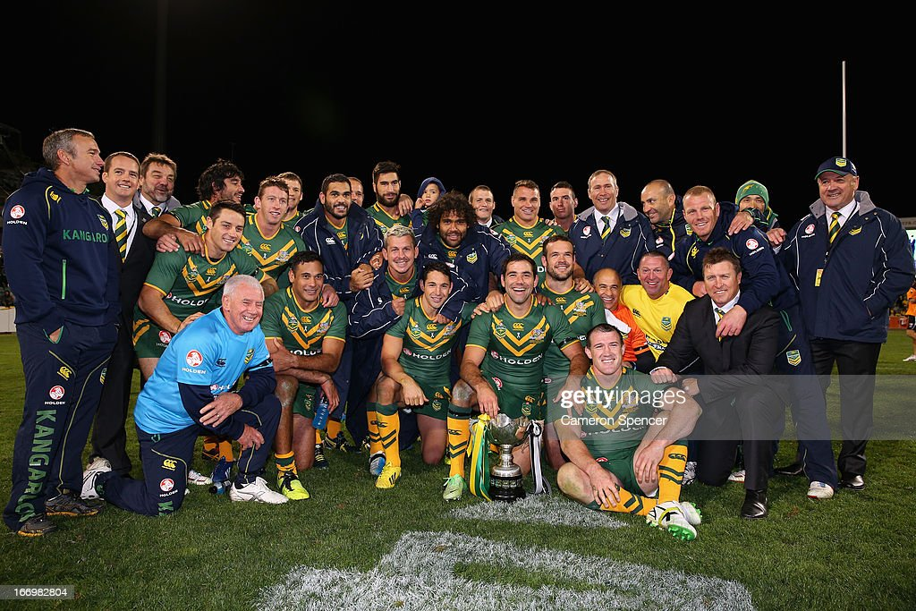 The Kangaroos pose with the trophy after winning the ANZAC Test match between the Australian Kangaroos and the New Zealand Kiwis at Canberra Stadium on April 19, 2013 in Canberra, Australia.