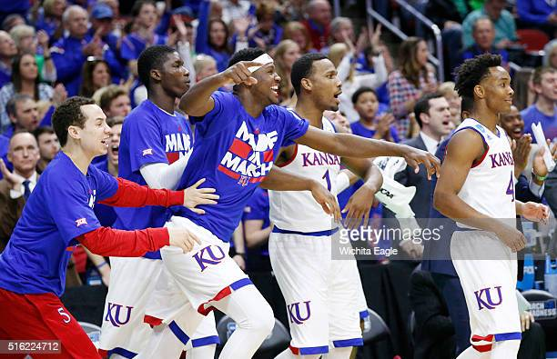 The Kansas bench celebrates amid a 10579 win against Austin Peay on Thursday March 17 in the first round of the NCAA Tournament at Wells Fargo Arena...