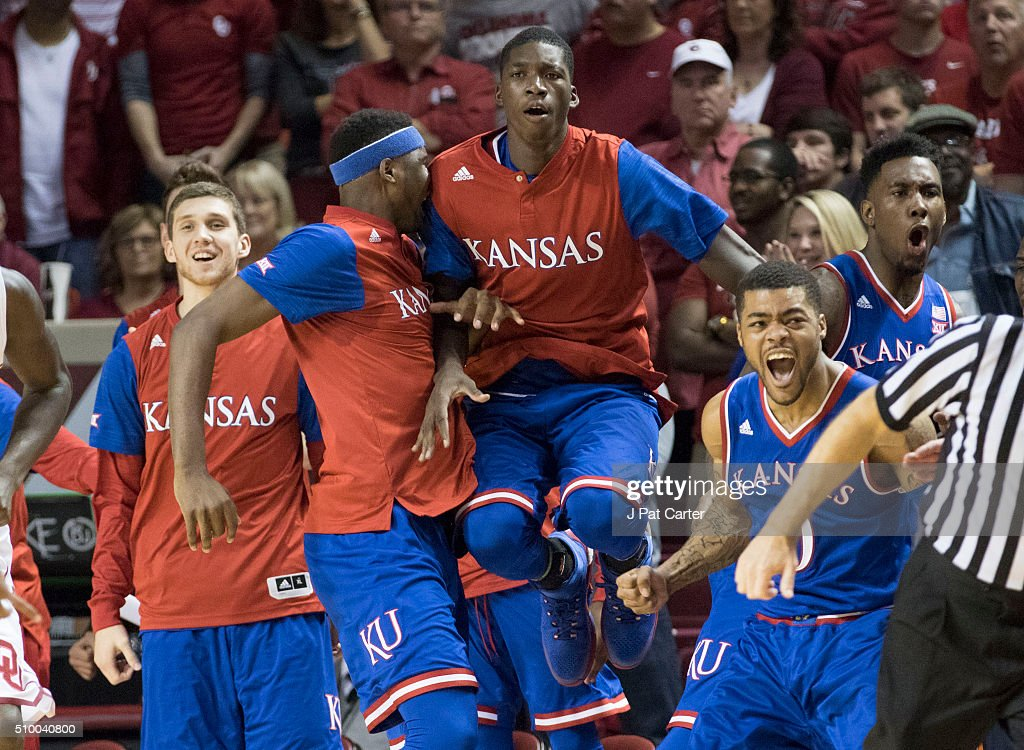 The Kansas bench react as the Jayhawks defeat Oklahoma during the second half of a NCAA college basketball game at the Lloyd Noble Center on February 13, 2016 in Norman, Oklahoma. Kansas won 76-72.