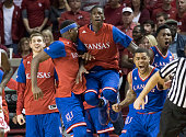 The Kansas bench react as the Jayhawks defeat Oklahoma during the second half of a NCAA college basketball game at the Lloyd Noble Center on February...