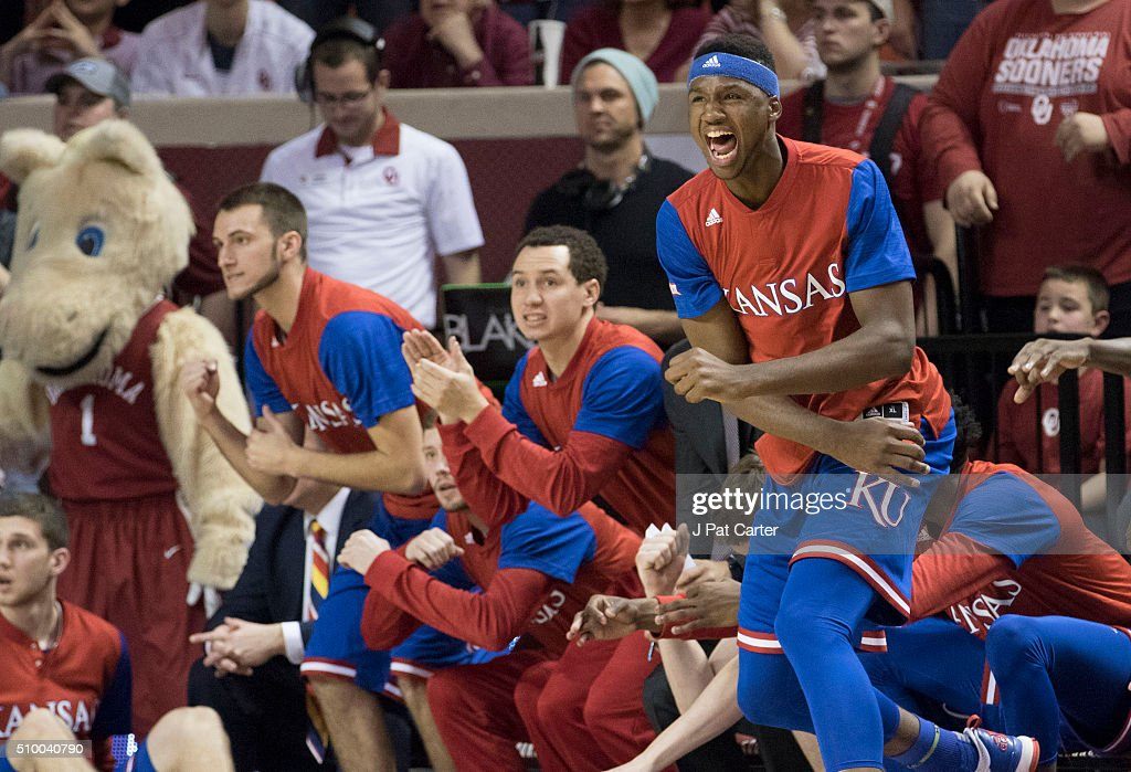 The Kansas bench reacts as the Jayhawks defeat Oklahoma during the second half of a NCAA college basketball game at the Lloyd Noble Center on February 13, 2016 in Norman, Oklahoma. Kansas won 76-72.