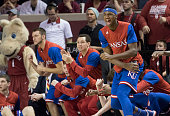 The Kansas bench reacts as the Jayhawks defeat Oklahoma during the second half of a NCAA college basketball game at the Lloyd Noble Center on...