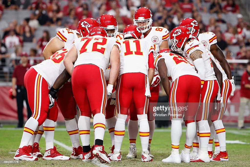 The Kansas City Chiefs huddle up around quarterback <a gi-track='captionPersonalityLinkClicked' href=/galleries/search?phrase=Alex+Smith+-+American+Football+Quarterback&family=editorial&specificpeople=4584854 ng-click='$event.stopPropagation()'>Alex Smith</a> #11 during the pre-season NFL game against the Arizona Cardinals at the University of Phoenix Stadium on August 15, 2015 in Glendale, Arizona. The Chiefs defeated the Cardinals 34-19.