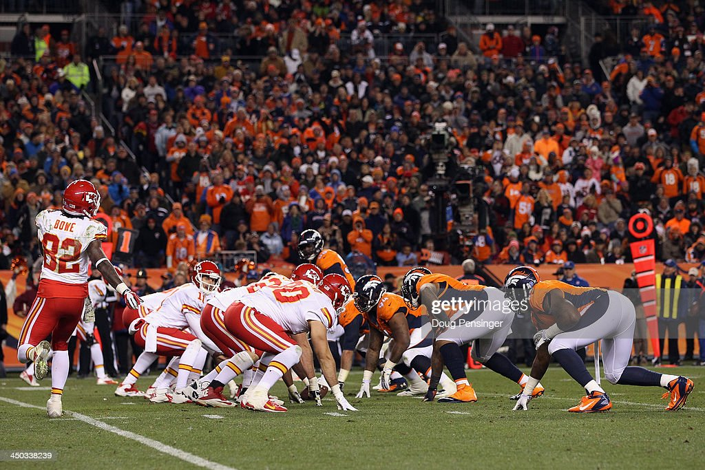 The Kansas City Chiefs offense faces off against the Denver Broncos defense on the line of scrimmage at Sports Authority Field at Mile High on November 17, 2013 in Denver, Colorado. The Broncos defeated the Chiefs 27-17.