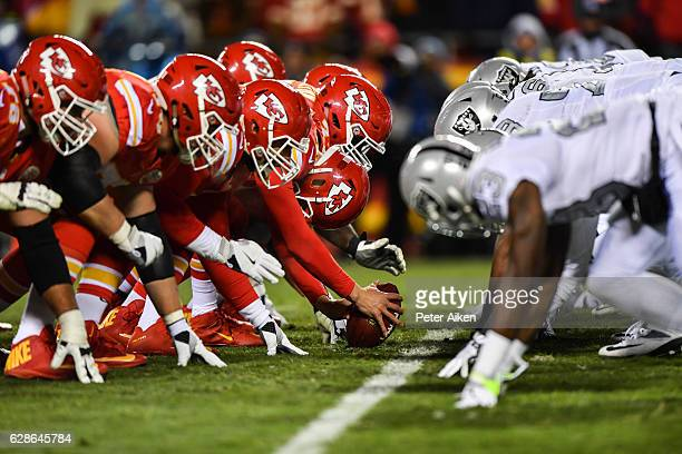 The Kansas City Chiefs offensive line and Oakland Raiders offensive line line up before a snap during the second quarter of the game at Arrowhead...