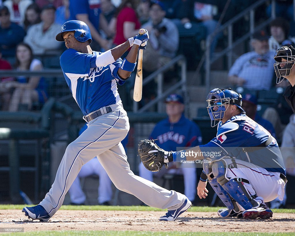 The Kansas City Royals' Alcides Escobar (2) follows through on a hit in the third inning of a spring training game against the Texas Rangers in Surprise, Arizona, Friday, February 22, 2013. The game ended in a 5-5 tie.
