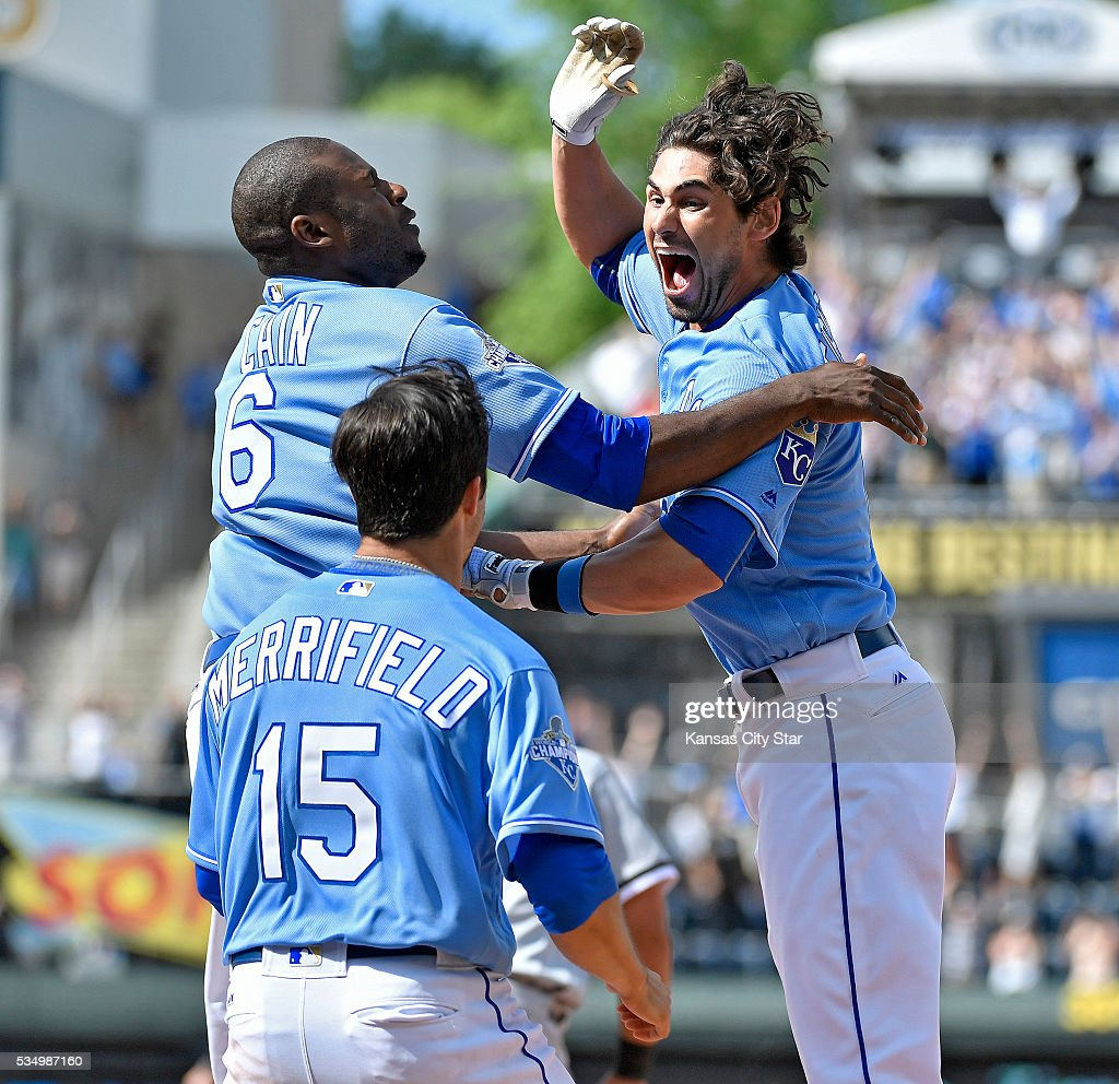 The Kansas City Royals' Brett Eibner celebrates with Lorenzo Cain (6) and Whit Merrifield (15) after getting the game-winning hit in the ninth inning in an 8-7 victory against the Chicago White Sox on Saturday, May 28, 2016, at Kauffman Stadium in Kansas City, Mo.