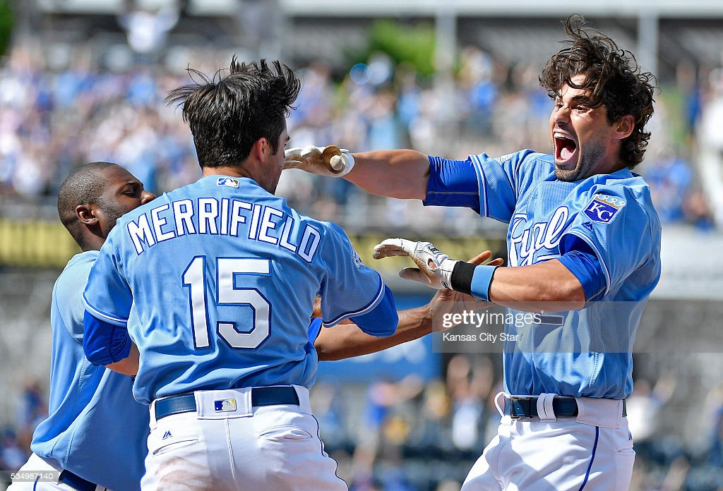 The Kansas City Royals' Brett Eibner, right, celebrates with Lorenzo Cain and Whit Merrifield (15) after getting the game-winning hit in the ninth inning in an 8-7 victory against the Chicago White Sox on Saturday, May 28, 2016, at Kauffman Stadium in Kansas City, Mo.