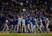 The Kansas City Royals celebrate after the final out of the ninth inning to defeat the Chicago White Sox and clinch a Wild Card berth at US Cellular...