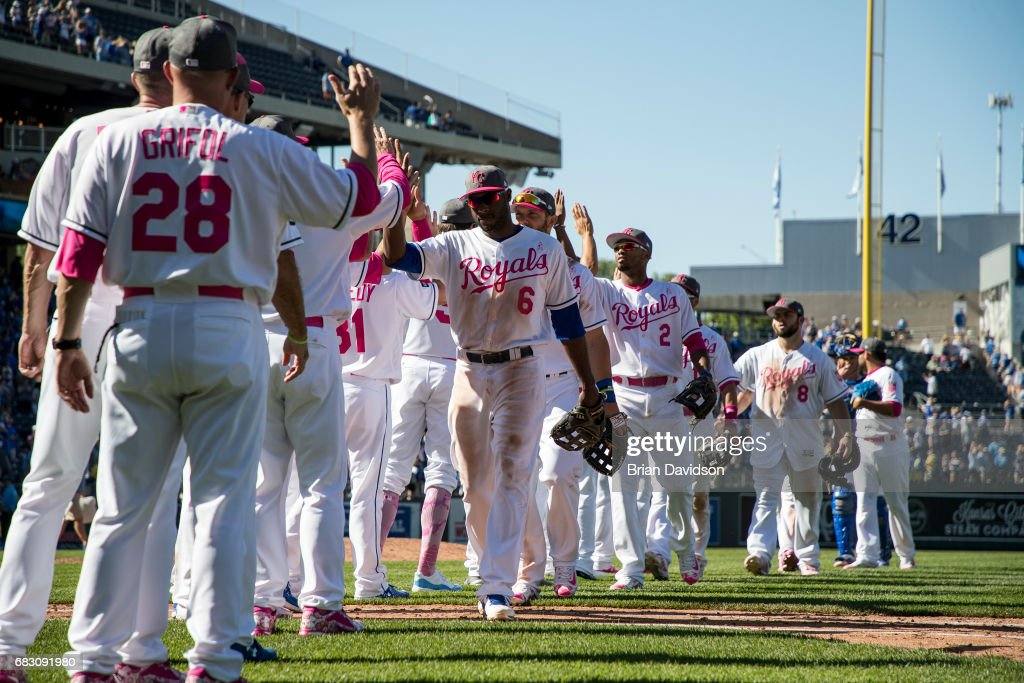 The Kansas City Royals celebrate defeating the Baltimore Orioles 9-8 during game at Kauffman Stadium on May 14, 2017 in Kansas City, Missouri. Players are wearing pink to celebrate Mother's Day weekend and support breast cancer awareness.