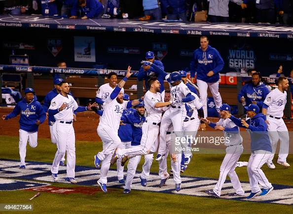 The Kansas City Royals celebrate defeating the New York Mets 54 in Game One of the 2015 World Series at Kauffman Stadium on October 27 2015 in Kansas...
