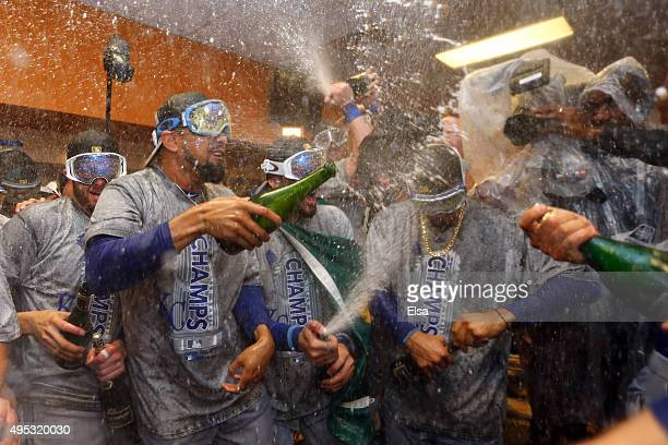 The Kansas City Royals celebrate in the clubhouse after defeating the New York Mets to win Game Five of the 2015 World Series at Citi Field on...