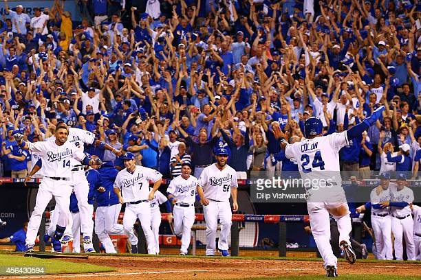 The Kansas City Royals celebrate their 9 to 8 win over the Oakland Athletics in the 12th inning of their American League Wild Card game at Kauffman...