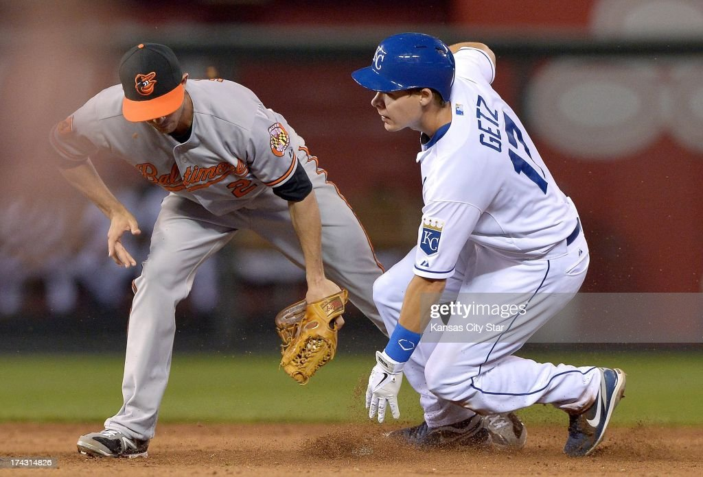 The Kansas City Royals' Chris Getz (17) steals second base before the tag from Baltimore Orioles shortstop J.J. Hardy in the sixth inning at Kauffman Stadium in Kansas City, Missouri, on Tuesday, July 23, 2013.