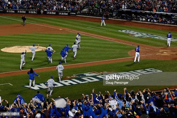 The Kansas City Royals dugout runs onto the field to celebrate with Wade Davis after defeating the New York Mets in Game Five of the 2015 World...