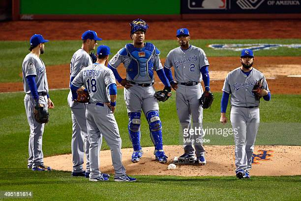 The Kansas City Royals infield stands have a meeting on the mound against the New York Mets during Game Four of the 2015 World Series at Citi Field...