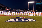 The Kansas City Royals line the base path during the National Anthem prior to Game 1 of the ALCS against the Toronto Blue Jays at Kauffman Stadium on...