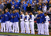 The Kansas City Royals line up during the national anthem before Game Seven of the 2014 World Series against the San Francisco Giants at Kauffman...