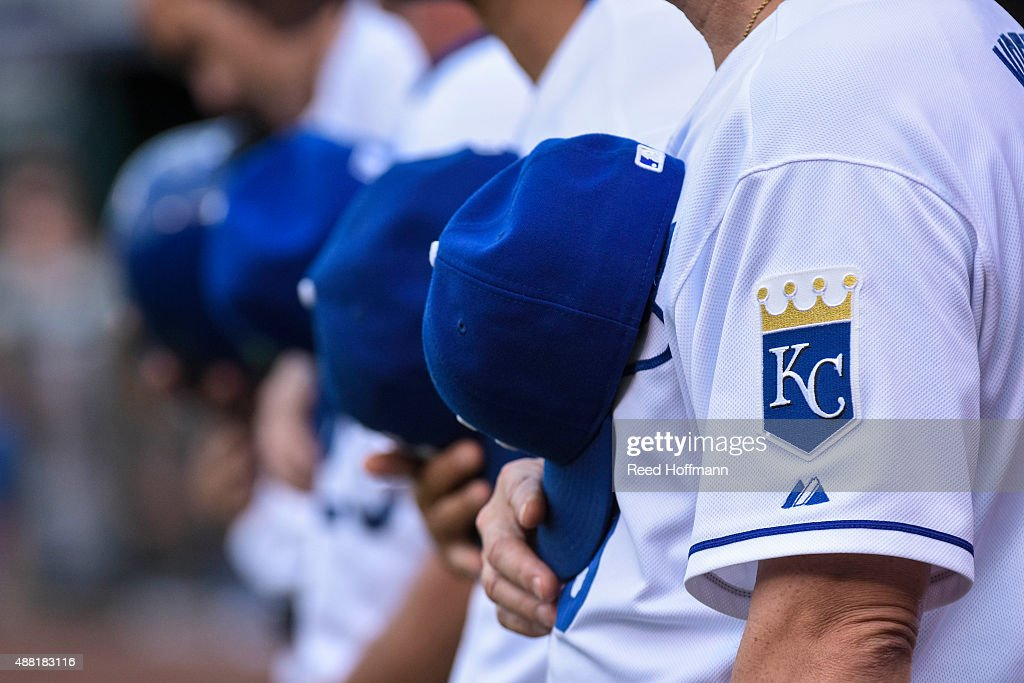 The Kansas City Royals line up for the national anthem before the first inning of a game at Kauffman Stadium on September 5 2015 in Kansas City...
