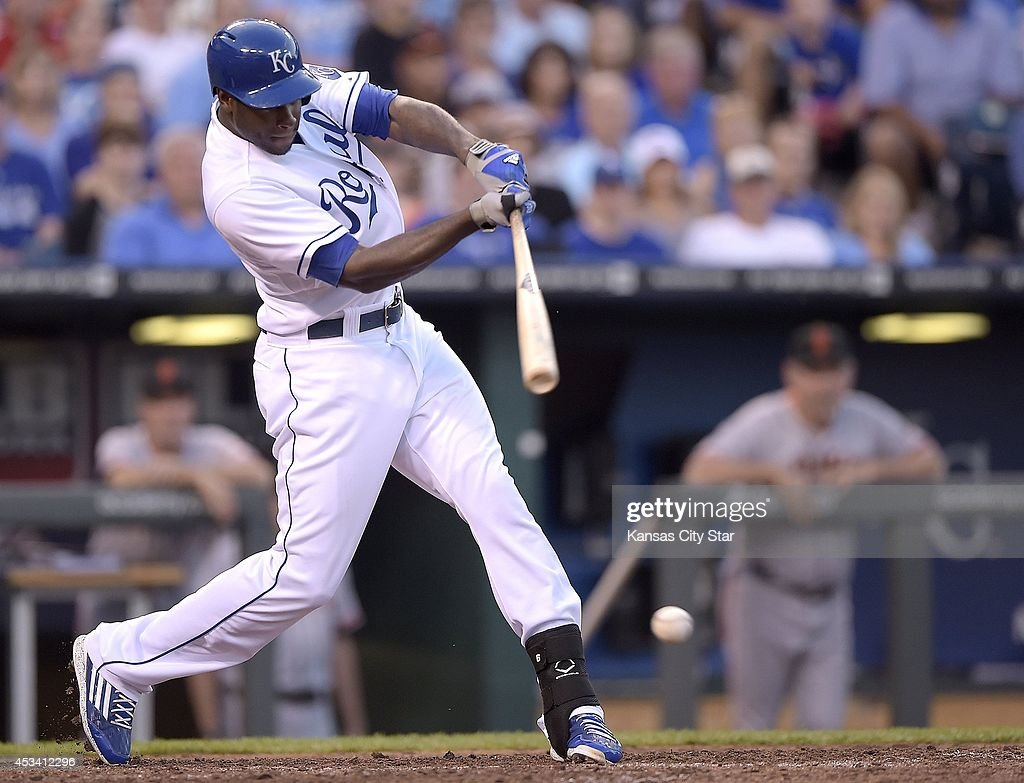The Kansas City Royals' Lorenzo Cain connects on an RBI single in the seventh inning against the San Francisco Giants on Saturday, Aug. 9, 2014, at Kauffman Stadium in Kansas City, Mo. The Royals won, 5-0.
