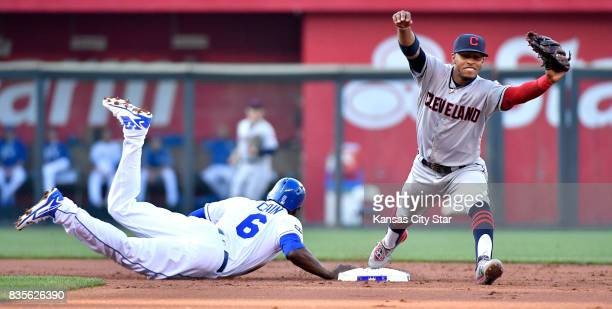 The Kansas City Royals' Lorenzo Cain dives back to second in time as the throw reaches Cleveland Indians shortstop Francisco Lindor after a line out...
