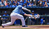 The Kansas City Royals' Mike Moustakas lays down a sacrifice bunt to advance Alcides Escobar to third in the first inning against the Toronto Blue...
