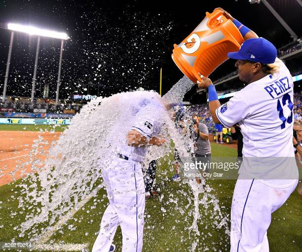 The Kansas City Royals' Salvador Perez inundates Brandon Moss with ice water after the team's 64 win against the Seattle Mariners at Kauffman Stadium...
