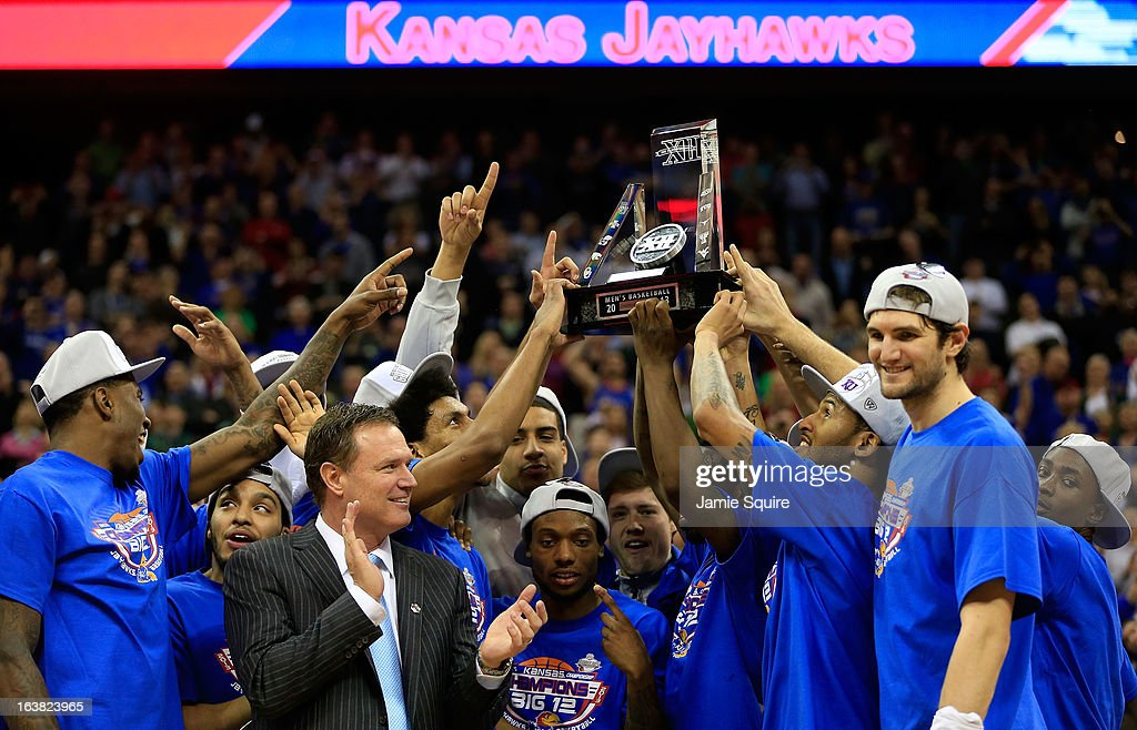 The Kansas Jayhawks and head coach Bill Self celebrate with the trophy after their 70-54 win over the Kansas State Wildcats during the Final of the Big 12 basketball tournament at Sprint Center on March 16, 2013 in Kansas City, Missouri.