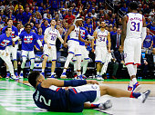 The Kansas Jayhawks bench reacts after Jamari Traylor blocked a shot by Jalen Adams of the Connecticut Huskies in the first half during the second...