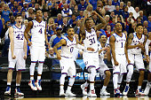 The Kansas Jayhawks bench reacts in the closing minutes against the New Mexico State Aggies during the second round of the 2015 NCAA Men's Basketball...
